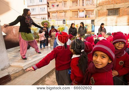 KATHMANDU, NEPAL - DEC 22: Unknown pupils during dance lesson in primary school, Dec 22, 2013 in Kathmandu, Nepal. Only only 25% of girls attend schools and half of the children can reach the 5 grade.