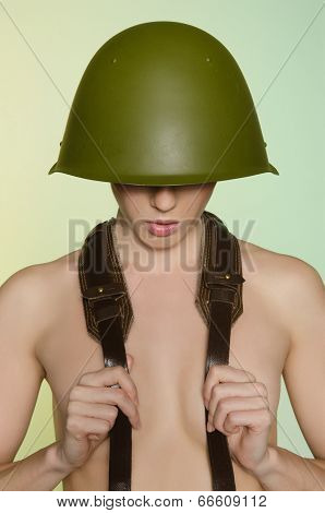 Woman In Army Helmet With A Belt On Neck