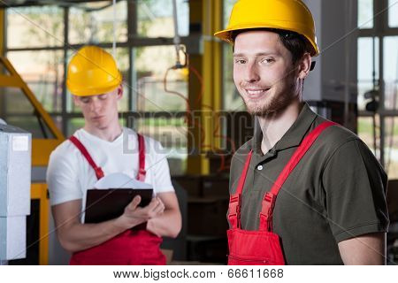 Two Specialists Working At Factory
