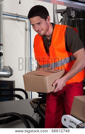 Blue-collar Worker Holding Box