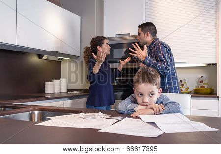 Sad child suffering and parents having discussion