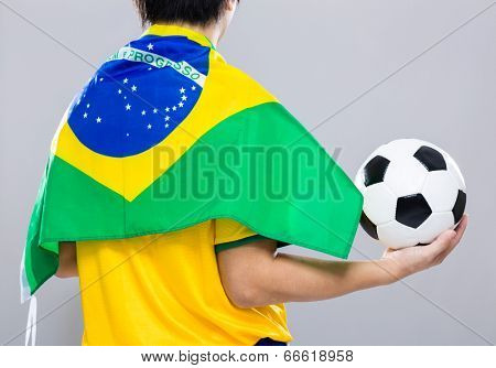Backview of sportman wear with Brazil flag and hold football