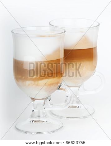Two Glass Mugs With Handles Of Latte Coffee, Macro Photo