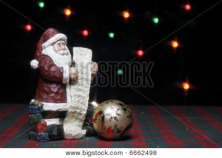Santa with list and ornament