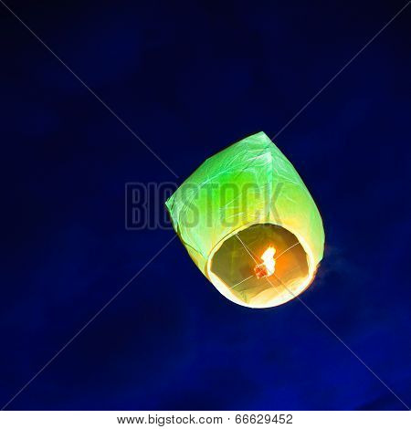 Chinese lantern afloat in the sky