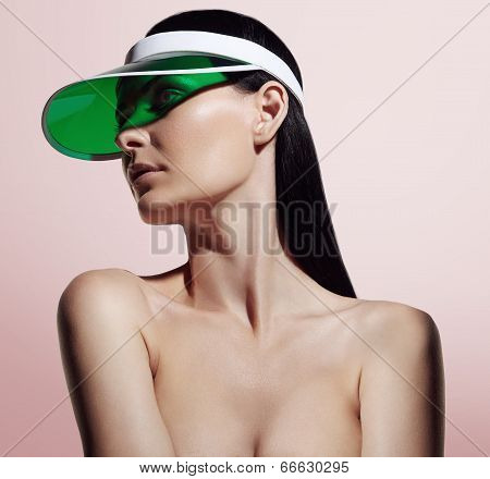 Portrait Of Attractive Young Adult Woman With Sun Visor