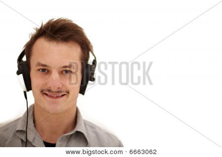 Happy Young Man Looking At You And Listening To Music