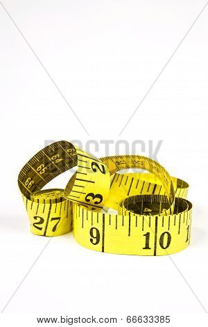 Measuring Tape With Applications In Tailoring In Yellow And Black