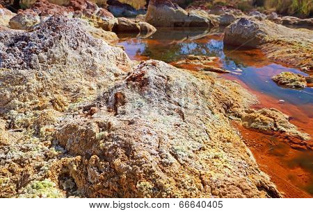 Stones By Acidic River Tinto In Spain