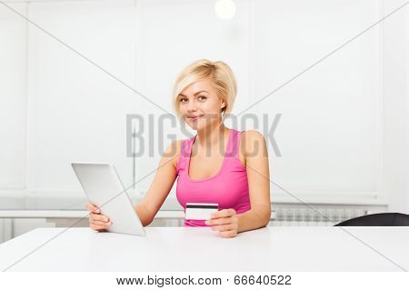 woman smile holding credit card with tablet