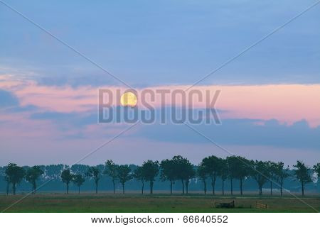 Full Moon Over Meadows At Sunrise