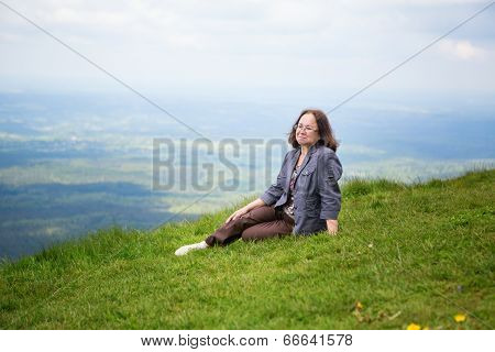 Middle Aged Woman On The Slope Of Volcano
