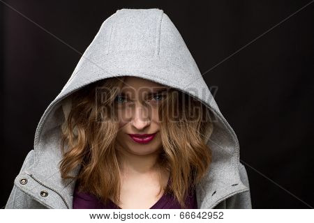 Coy Or Shy Young Woman Wearing A Hood
