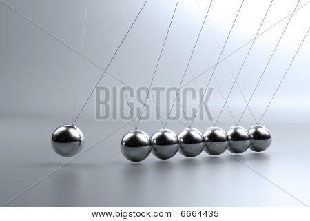 Metal Pendulum Balls Balancing From Strings In Newton's Cradle