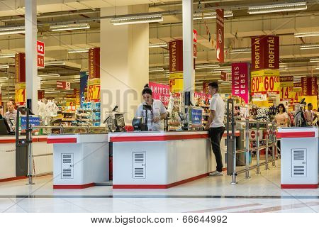People Check Out At Local Supermarket
