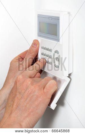 Hands Entering A Code