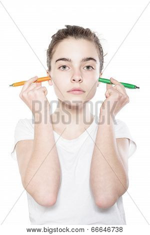 Funny Teenager Girl Holding To Pens In Her Ears, Isolated On White