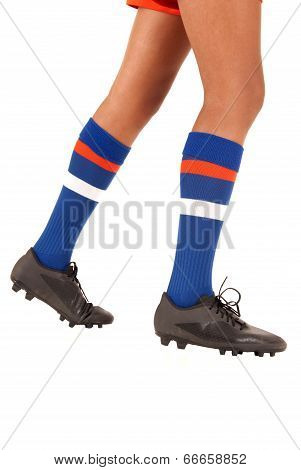 White Background Of Soccer Football Legs Knee Socks And Shoes Or Cleats