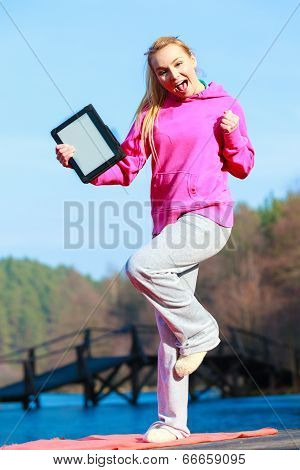 Woman Teenage Girl In Pink Tracksuit Showing Blank Tablet Outdoor