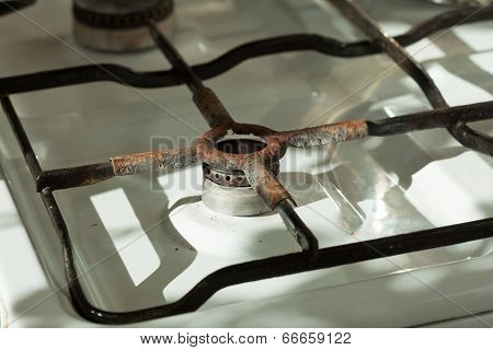 Closeup Of Old Rusty Gas Stove In Domestic Kitchen