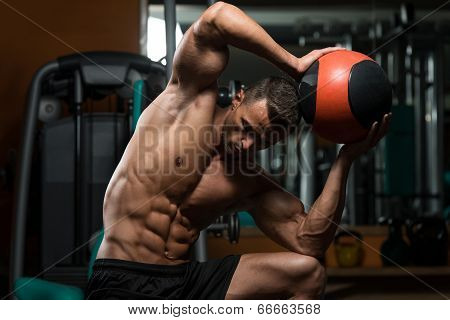Athletic Man Workout With Medical Ball