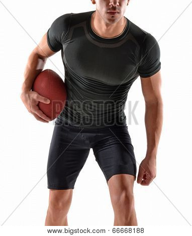 athletic man holding a rugby ball on white background.Strong rugby player.