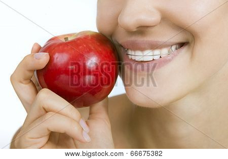Smiling Girl With Retainer For Teeth And Apple