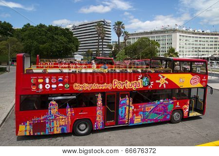 LISBON, PORTUGAL - MAY 26, 2014: A City Sightseeing bus in Lisbon. City Sightseeing operates in 100 locations worldwide and carry a combined total of around eight million passengers per year.