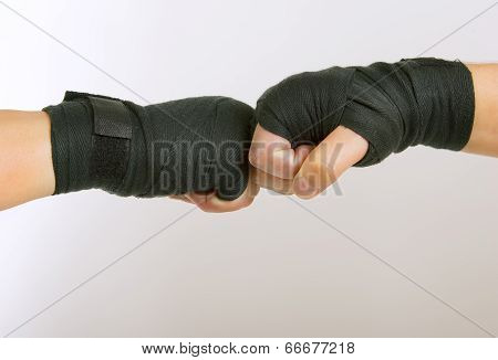 Two Hands In A Black Boxing Bandage Arm Wrestling, Clasped