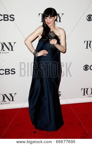 NEW YORK-JUNE 8: Actress Lena Hall poses in the press room at the American Theatre Wing's 68th Annual Tony Awards at Radio City Music Hall on June 8, 2014 in New York City.