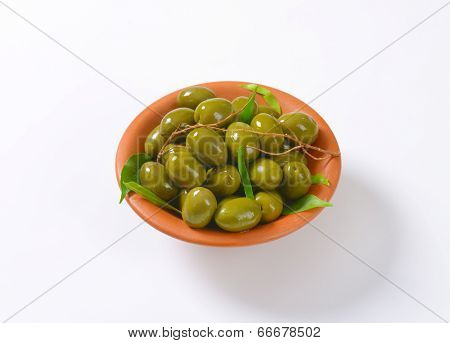 greek olives with stones, served in the ceramic bowl
