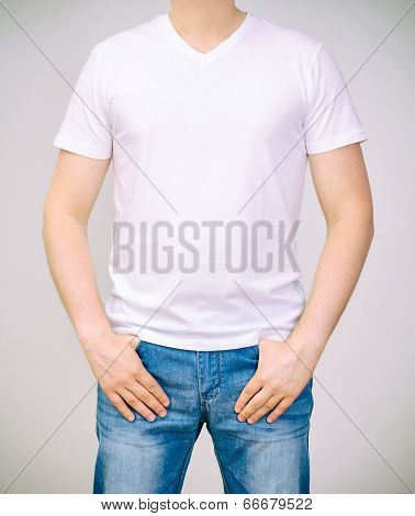 Man In White T-shirt. Grey Background.