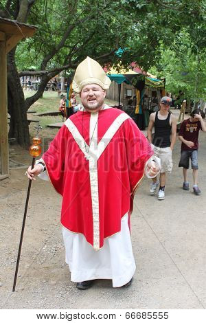 MUSKOGEE, OK - MAY 24: A man dressed as a cardinal poses for a picture at the Oklahoma 19th annual Renaissance Festival on May 24, 2014 at the Castle of Muskogee in Muskogee, OK.