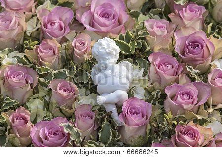 Pink roses and an angel