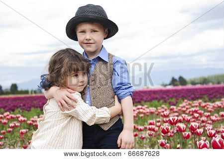 Farmer Boy with Girl in Tulip Field