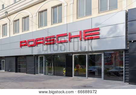 Samara, Russia - June 12, 2014: Porsche Automobile Dealership Sign. Porsche Is A German Holding Comp