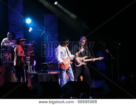 ATLANTIC CITY, NJ - JUNE 13: Musician Carlos Santana (C) performs with Tommy Anthony (R) and the rest of the Santana band at The Borgata Hotel & Casino on June 13, 2014 in Atlantic City, NJ.