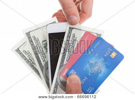 Hand Holding Banknotes Credit Cards And A Tablet