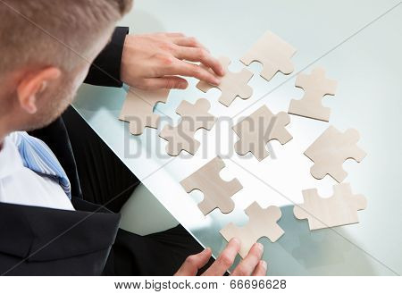 Businessman With A Jigsaw Puzzle