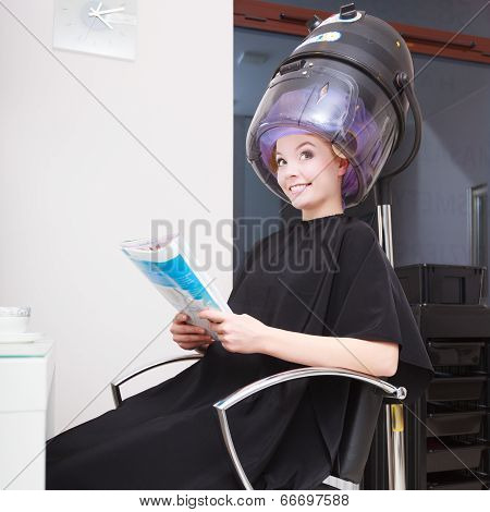 Woman Client Curlers  In Hair Reads Magazine Hairdressing Beauty Salon.