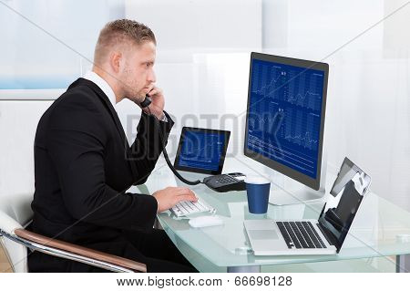 Hardworking Businessman At His Desk