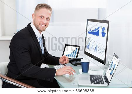 Businessman With Good Performance Graph