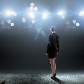 picture of stage decoration  - Rear view of businesswoman standing in lights of stage - JPG