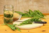stock photo of ribwort  - Making medicinal mixture from herbs against strong cough