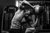image of human beings  - Muscular Man Exercise With Medical Ball In Gym - JPG