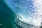 picture of tubes  - Ocean Blue wave wall inside of tube crashing water crashing breaking onto beach shallow sandbars reefs with  power energy and scenic beauty of nature