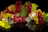 foto of jelly babies sugar  - colorful pile of gummy bears in black back - JPG