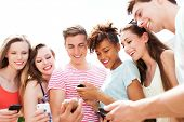 foto of friendship day  - Young people looking at smartphones  - JPG