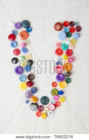 Letter V Of The Alphabet Of Buttons Of Various Shapes And Colors