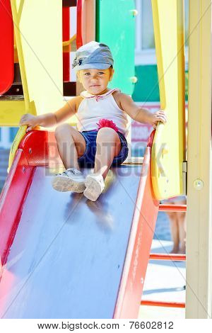 Cute Toddler Girl On The Slide